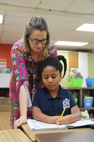 Cassie Jacobs assists Diyari with math schoolwork