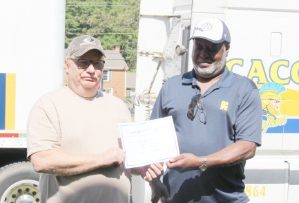 Instructor Willie Brooks presents Woodle with his certificate