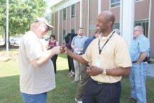 Woodle and Vocational Rehabilitation Counselor Quentin Morris exchange a fist bump to celebrate