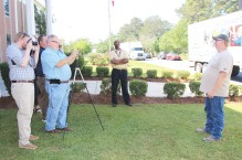 Reporters from The Alexander City Outlook and Overdrive Magazine interview Woodle