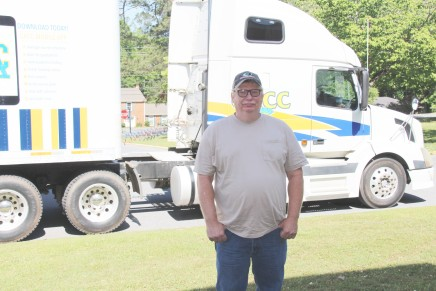 Woodle stands in front of the truck he used to pass his CDL
