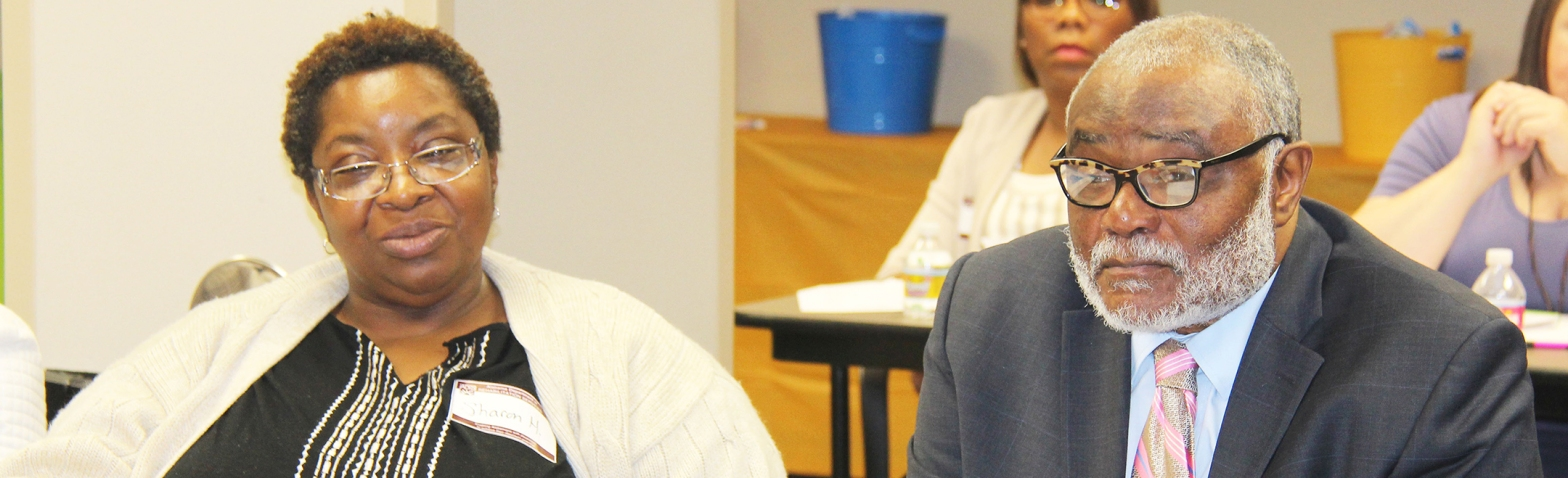 Sharon Henderson, a parent consultant in the Opelika CRS office, and new CRS Medical Consultant Dr. Albert Holloway listen during the recent statewide meeting of the Parent Advisory Committee.